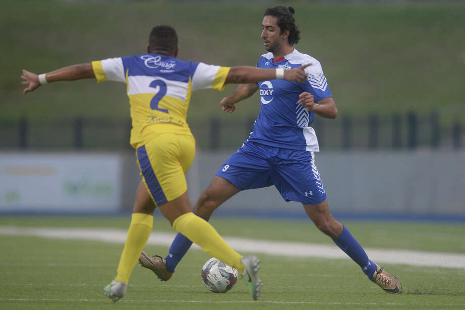 Midland-Odessa FC's Ricardo Palomino (9) keeps the ball away from  Shreveport's Mark Hammond (2) during the NPSL Lone Star Conference final on July 15, 2017, at Grande Communications Stadium. James Durbin/Reporter-Telegram Photo: James Durbin