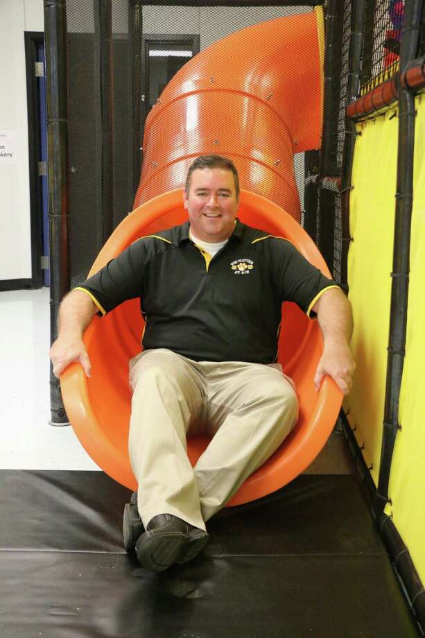 San Jacinto Elementary Principal Tom Connelly checks out the new indoor playground in the Pre-K department. The playground was purchased through a grant awarded to the school this year. Photo: David Taylor