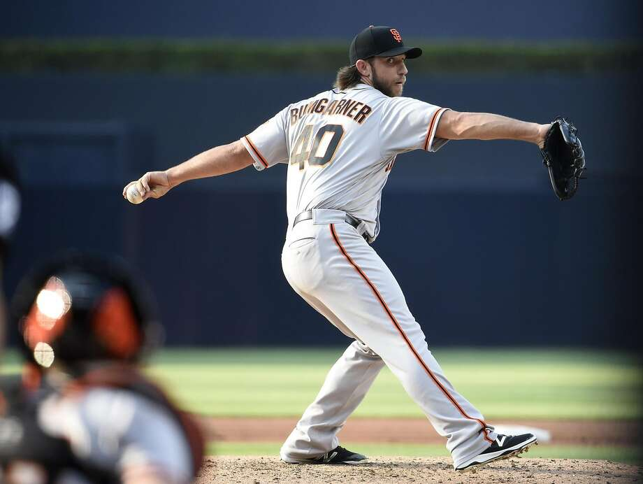 Madison Bumgarner #40 of the San Francisco Giants pitches during the first inning of a baseball game against the San Diego Padres at PETCO Park on July 15, 2017 in San Diego, California. Photo: Denis Poroy, Getty Images