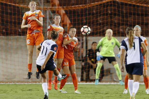 Houston Dash forward Janine Beckie (16), midfielder Andressa Cavalari Machry (17), and midfielder Caity Heap (27) defend a penalty kick by Washington Spirit Mallory Pugh (11) in the second half during the NWSL game between the Washington Spirit and Houston Dash on Saturday July 15, 2017.  The Dash defeated the Spirit 2-1.