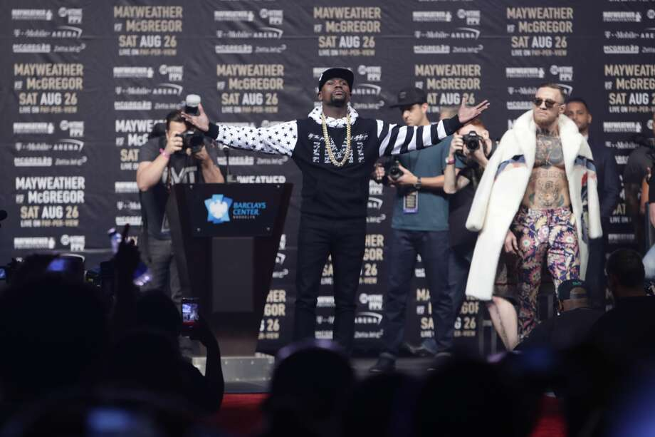 Floyd Mayweather Jr., left, poses as Conor McGregor, of Ireland, right watches during a news conference at Barclays Center Thursday, July 13, 2017, in New York. (AP Photo/Frank Franklin II) Photo: Frank Franklin II/Associated Press