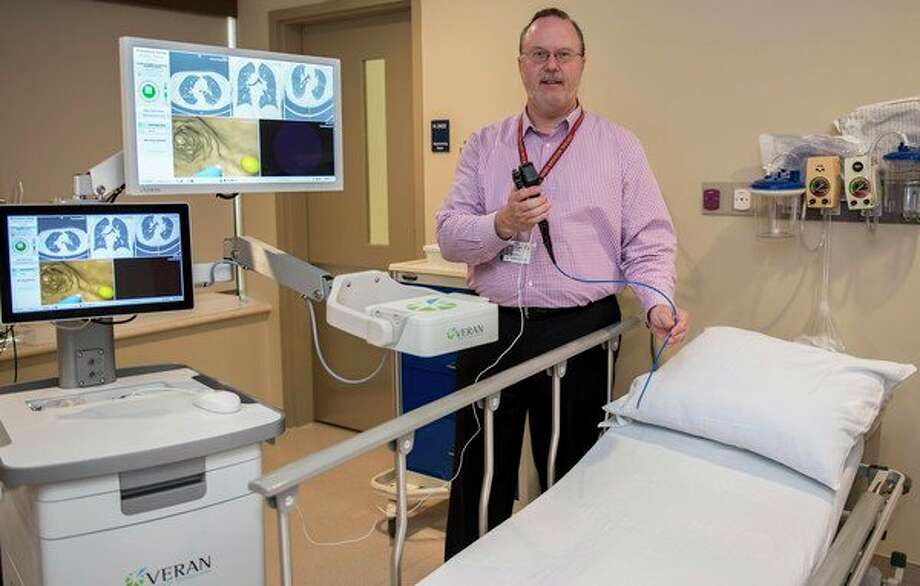 Brian Kinney, respiratory care and sleep disorders manager at MidMichigan Health, demonstrates the 3-D mapping capabilities of the SPiN Thoracic Navigation System. (Photo provided)