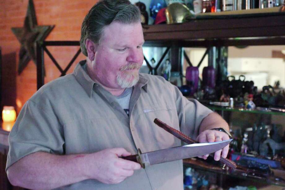 Knife collector Lloyd Lively discusses a Cold Steel Laredo Bowie knife that will become legal to carry in public after revised knife-carry laws go into effect Sept. 1. Photo: Kirk Sides / © 2017 Kirk Sides / Houston Chronicle