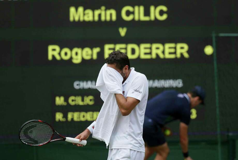 Croatia's Marin Cilic walks back to his seat after his service was broken by Switzerland's Roger Federer in the Men's Singles final match on day thirteen at the Wimbledon Tennis Championships in London Sunday, July 16, 2017. Photo: Tim Ireland, AP / Copyright 2017 The Associated Press. All rights reserved.