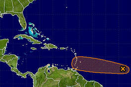 A tropical disturbance has about a 40 percent chance of developing in the next five days.