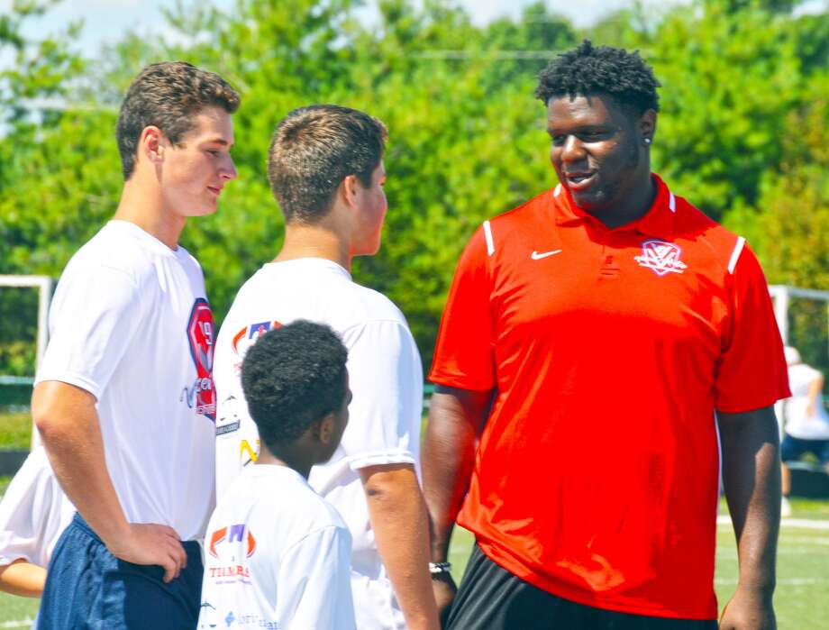 Vincent Valentine talks to a couple of campers.