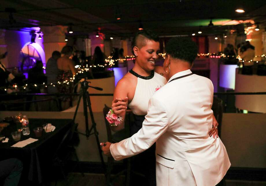 Liz Heck, left, and girlfriend Sabrina Oliver have a dance at Houston Gay Prom, an attempt to reclaim what many in the LGBT community missed out on in high school, Saturday, July 15, 2017, in Houston. Heck was nominated for prom royals. Photo: Yi-Chin Lee, Houston Chronicle / © 2017  Houston Chronicle