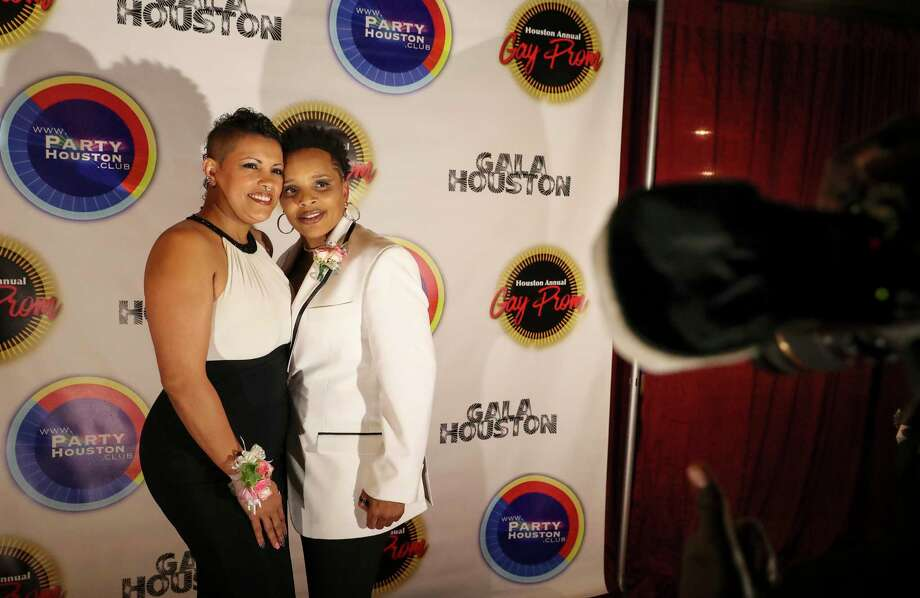 Liz Heck, left, and girlfriend Sabrina Oliver have their prom photo taken on the red carpet of the Houston Gay Prom, an attempt to reclaim what many in the LGBT community missed out on in high school, Saturday, July 15, 2017, in Houston. Heck was nominated for prom royals. Photo: Yi-Chin Lee, Houston Chronicle / © 2017  Houston Chronicle
