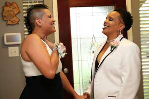 Liz Heck, left, and girlfriend Sabrina Oliver share a moment as they are ready to attend the Houston Gay Prom, an attempt to reclaim what many in the LGBT community missed out on in high school, Saturday, July 15, 2017, in Cypress.