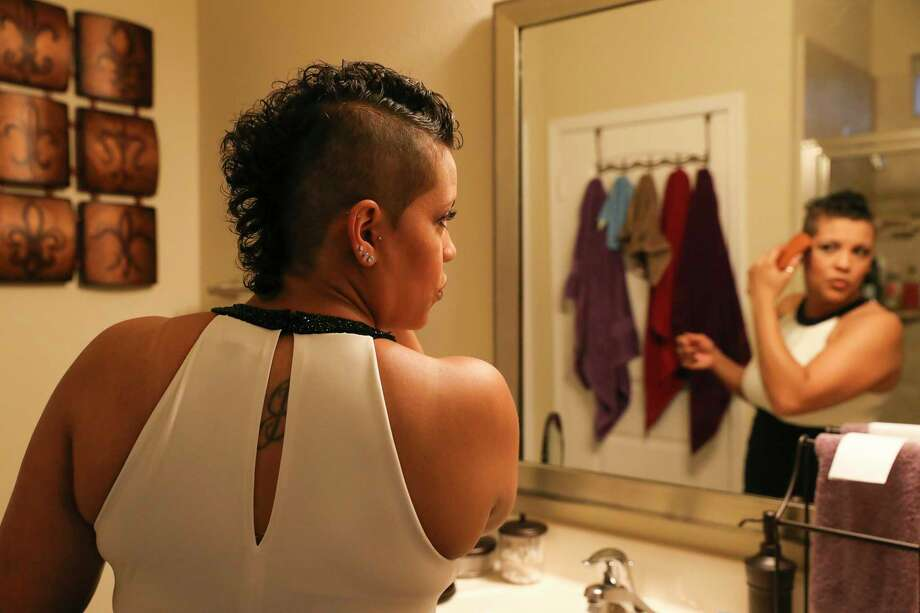 Liz Heck, 39, makes sure her hair is perfect before she and her girlfriend attending Houston Gay Prom, an attempt to reclaim what many in the LGBT community missed out on in high school, at their house Saturday, July 15, 2017, in Cypress. Photo: Yi-Chin Lee, Houston Chronicle / © 2017  Houston Chronicle