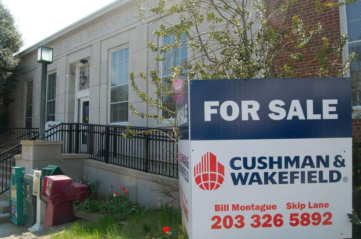 """A """"For sale"""" sign placed in front of Westport's main post office at 154 Post Road East is shown in this April 2010 file photo."""