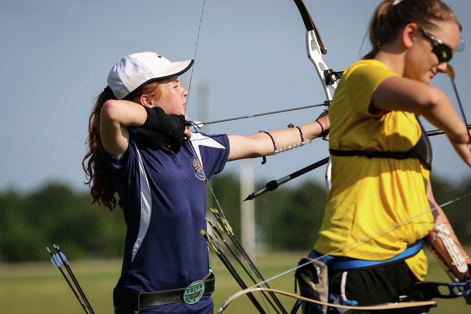 Thirteen-year-old Jordan Meiners, of The Woodlands, takes aim with an Olympic recurve bow during one of the Texas State Archery Association's Texas Outdoor Target Series on Saturday on the fields outside of the Lone Star Convention and Expo Center. Photo: Michael Minasi, Staff Photographer / © 2017 Houston Chronicle