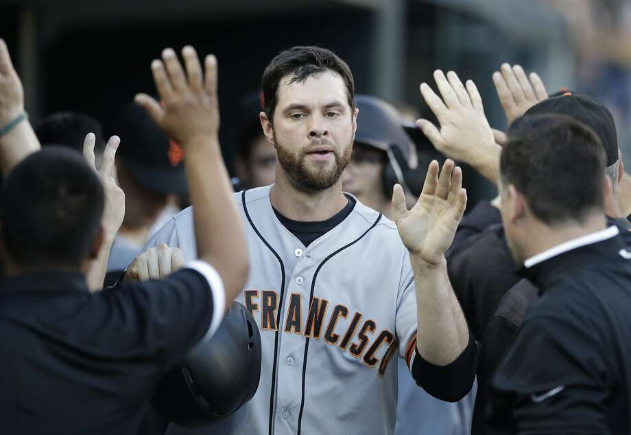 San Francisco Giants first baseman Brandon Belt is greeted in the dugout after scoring during the fourth inning of the team's baseball game against the Detroit Tigers, Wednesday, July 5, 2017, in Detroit. (AP Photo/Carlos Osorio) Photo: Carlos Osorio, Associated Press