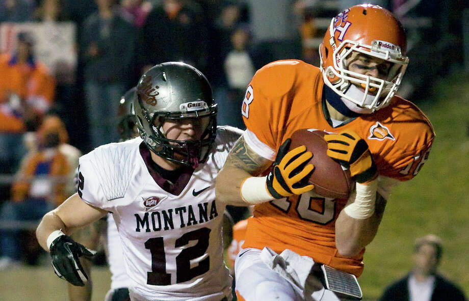 Sam Houston State wide receiver Trey Diller (18) makes a touchdown reception in the first quarter of an NCAA college football championship subdivision semifinal playoff game against Montana at Bowers Stadium, Friday, Dec. 16, 2011, in Huntsville, Texas.  (AP Photo/The Courier, Joseph Buvid) Photo: Joseph Buvid, MBO / AP