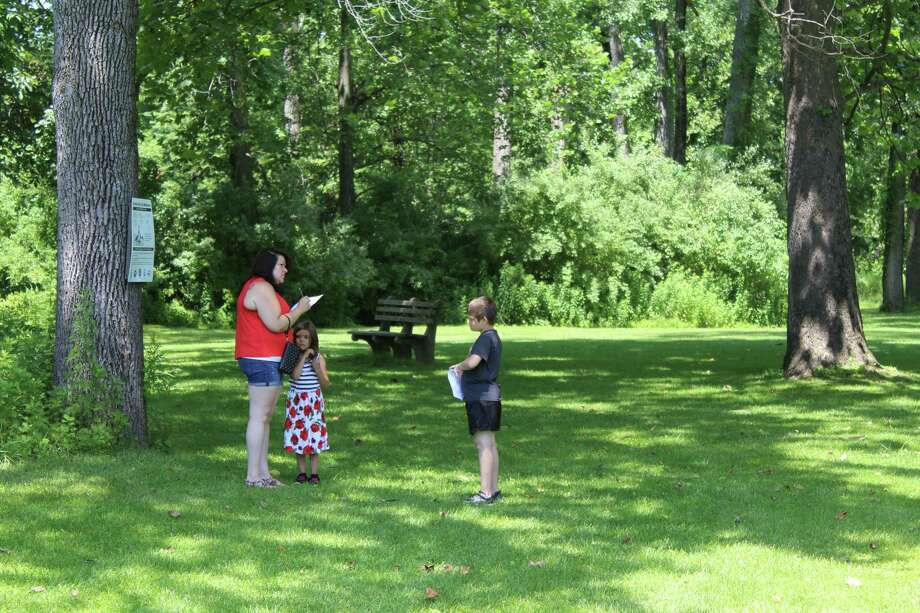 Danbury resident Letitia Beardsley participates in the Harrybrooke Park scavenger hunt with two of her four kids, Lola and Damian Almonte. Photo: Julia Perkins /