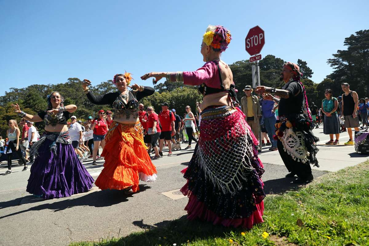 House of Inanna belly dancers perform during AIDS Walk San Francisco in Golden Gate Park in San Francisco, Calif. on Sunday, July 16, 2017.