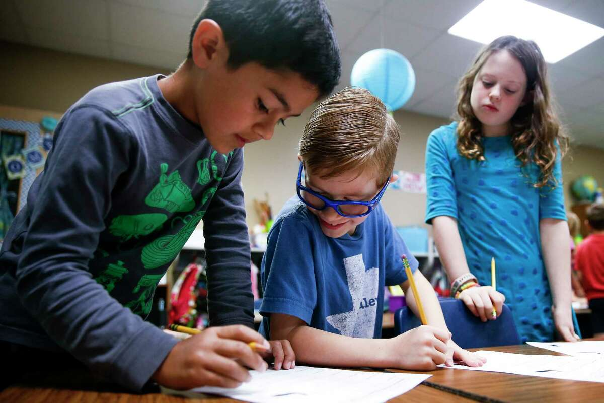 Buckalew Elementary School second grader Colton Cooper, center, looks over at Jake West's worksheet during science class Thursday, May 18, 2017 in Conroe. Buckalew Elementary School is the top ranking elementary school in the greater Houston area in the 2017 Children at Risk Annual School rankings. ( Michael Ciaglo / Houston Chronicle )