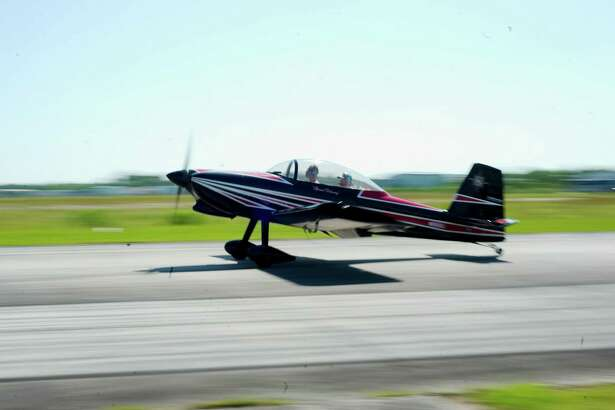 A small airplane lands at Pearland Regional Airport Wednesday, Jun. 7.