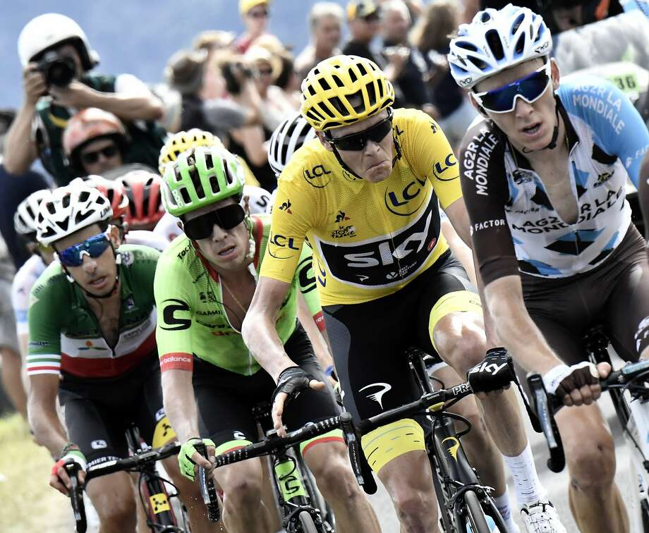 Britain's Chris Froome, wearing the overall leader's yellow jersey, grimaces as he climbs with France's Romain Bardet (right), Colombia's Rigoberto Uran (second left) and Italy's Fabio Aru (left) in Sunday's Stage 15. Photo: Jeff Pachoud, Associated Press