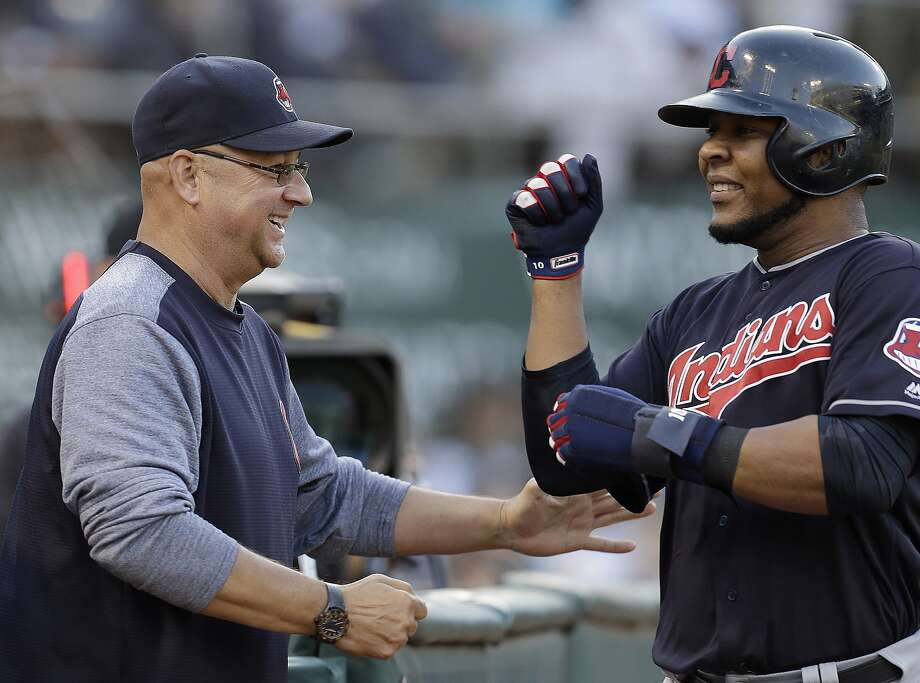 Cleveland Indians' Edwin Encarnacion, right, is congratulated by manager Terry Francona after scoring against the Oakland Athletics in the sixth inning of a baseball game Saturday, July 15, 2017, in Oakland, Calif. Encarnacion scored on a ground-out by Indians' Carlos Santana. (AP Photo/Ben Margot) Photo: Ben Margot, Associated Press