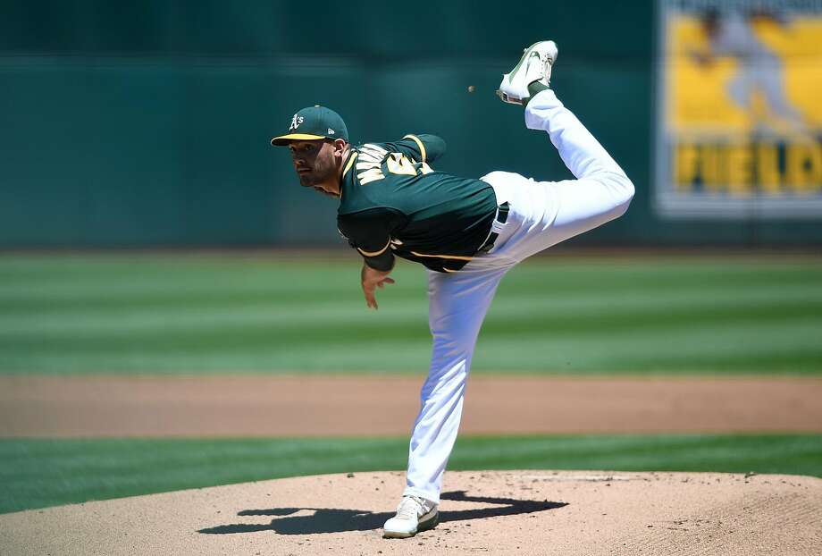 OAKLAND, CA - JULY 16:  Sean Manaea #55 of the Oakland Athletics pitches against the Cleveland Indians in the top of the first inning at Oakland Alameda Coliseum on July 16, 2017 in Oakland, California.  (Photo by Thearon W. Henderson/Getty Images) Photo: Thearon W. Henderson, Getty Images