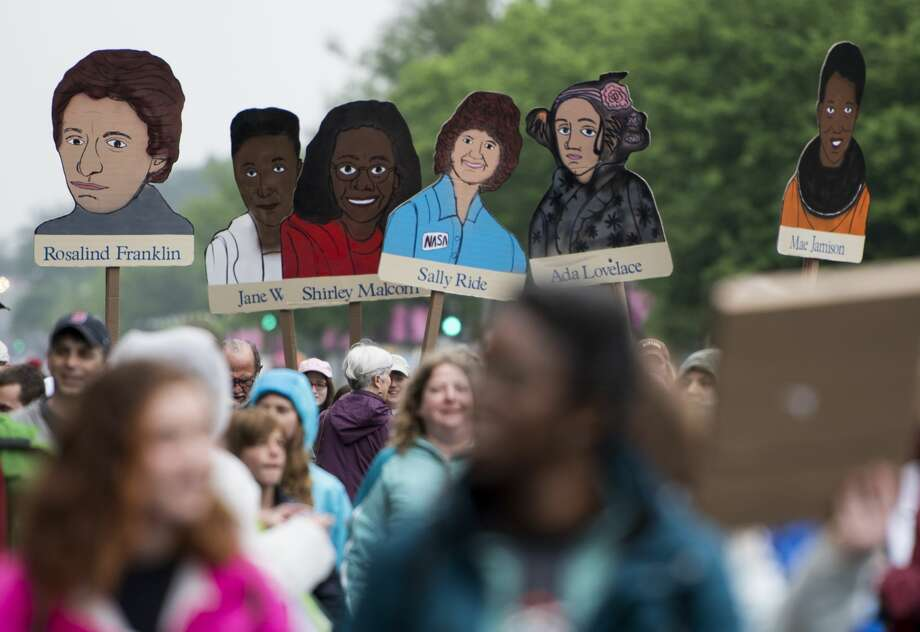 Marchers carry portraits of women scientists down Constitution Avenue in Washington during the Science March on Earth Day, Saturday, April 22, 2017. Photo: Bill Clark/CQ-Roll Call, Inc.