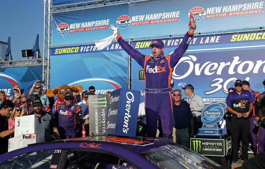 Driver Denny Hamlin celebrates after winning the NASCAR Cup Series 301 auto race at the New Hampshire Motor Speedway in Loudon, N.H., Sunday. Photo: Charles Krupa, STF / Copyright 2017 The Associated Press. All rights reserved.
