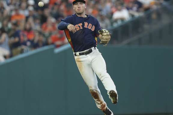 Houston Astros third baseman Alex Bregman (2) throws the ground ball to first baseman Yuli Gurriel (10) and out Minnesota Twins designated hitter Kennys Vargas (19)  during the top seventh inning of the game at Minute Maid Park Sunday, July 16, 2017, in Houston. ( Yi-Chin Lee / Houston Chronicle )