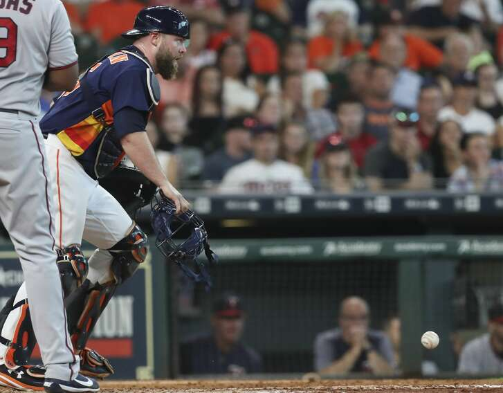 Houston Astros catcher Brian McCann (16) keeps his eyes on Minnesota Twins players on the base while retrieving a ball during the top ninth inning of the game at Minute Maid Park Sunday, July 16, 2017, in Houston. Houston Astros defeated Minnesota Twins 5-3.( Yi-Chin Lee / Houston Chronicle )