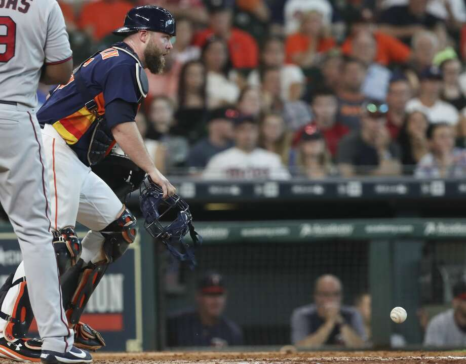 Houston Astros catcher Brian McCann (16) keeps his eyes on Minnesota Twins players on the base while retrieving a ball during the top ninth inning of the game at Minute Maid Park Sunday, July 16, 2017, in Houston. Houston Astros defeated Minnesota Twins 5-3.( Yi-Chin Lee / Houston Chronicle ) Photo: Yi-Chin Lee/Houston Chronicle