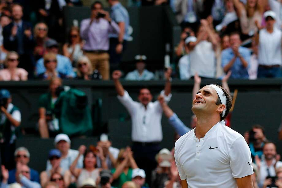 Roger Federer is overcome by emotionafter winning his eighth Wimbledon title. Photo: ADRIAN DENNIS, AFP/Getty Images
