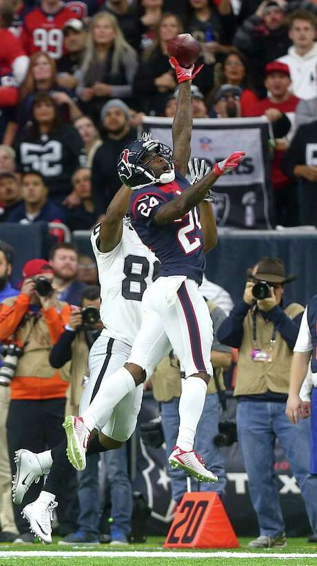 Texans cornerback Johnathan Joseph, right, deflects a pass intended for the Raiders' Amari Cooper in the playoff game. Joseph had 45 tackles and defensed nine passes last season. Photo: Jon Shapley, Staff / © 2015  Houston Chronicle