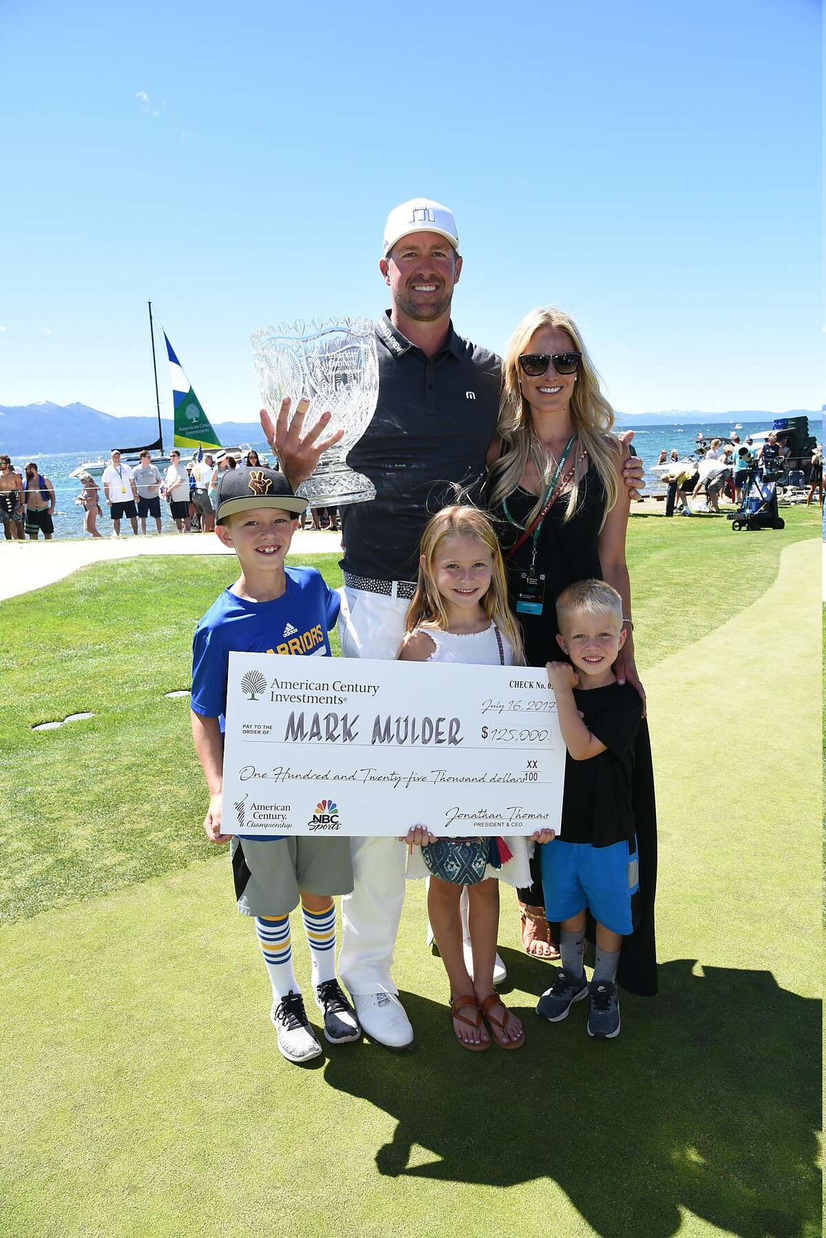 Mark Mulder poses with his family after winning the American Century Championship in Stateline Nevada on Sunday July 16, 2017.