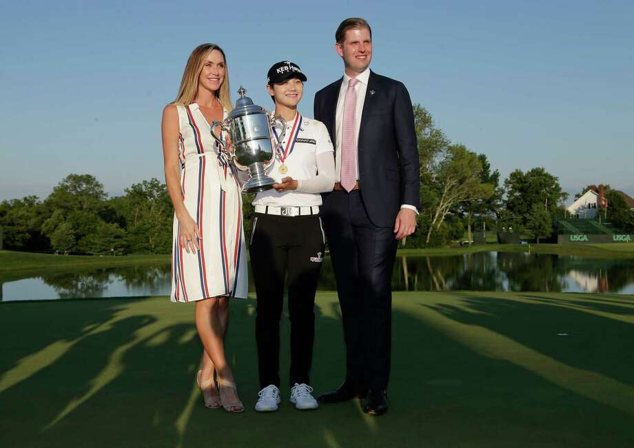South Korea's Sung Hyun Park poses for a photo with Eric Trump and Trump's wife, Lara Yunaska, after winning the U.S. Women's Open Golf tournament, Sunday in Bedminster, N.J. Photo: Seth Wenig, Associated Press / Copyright 2017 The Associated Press. All rights reserved.