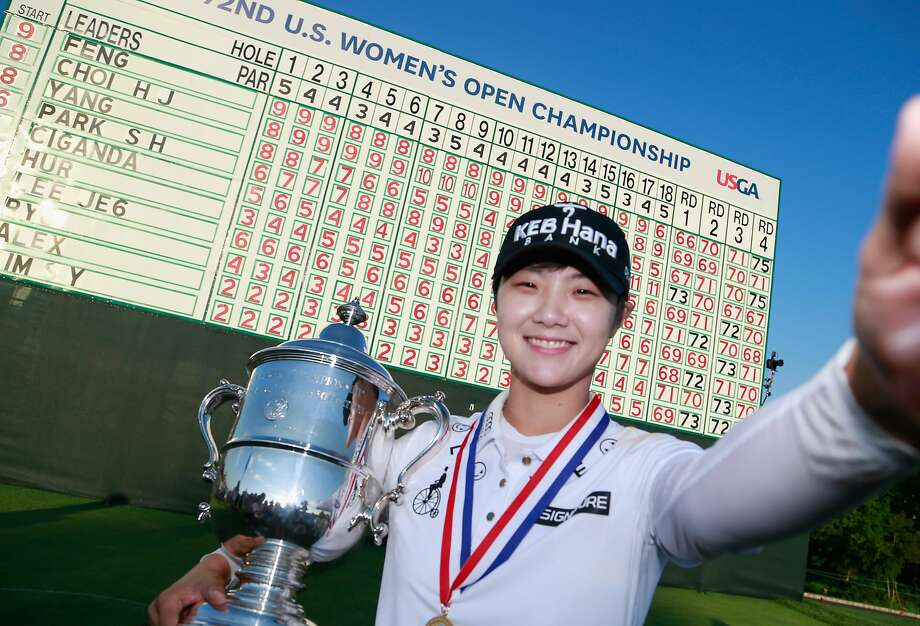 """Sung Hyun Park of South Korea imitates a """"selfie"""" with the championship trophy after winning the U.S. Women's Open Championship at Trump National Golf Club in Bedminster, N.J. Photo: Matt Sullivan, Getty Images"""