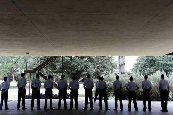 Air Force trainees line up Thursday July 13, 2017 under what is called an overhang at one of Lackland Air Force Base's older dorm buildings built in the early 1970s. The Air Force's Air Education and Training Command is mapping construction plans that is calling for modernization of key facilities such as dormitories.