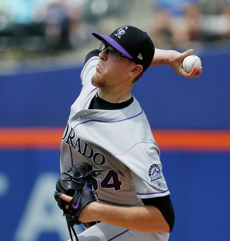 Colorado Rockies starting pitcher Jeff Hoffman winds up during the first inning of a baseball game against the New York Mets, Sunday, July 16, 2017, in New York. (AP Photo/Kathy Willens) ORG XMIT: NYM102 Photo: Kathy Willens / Copyright 2017 The Associated Press. All rights reserved.