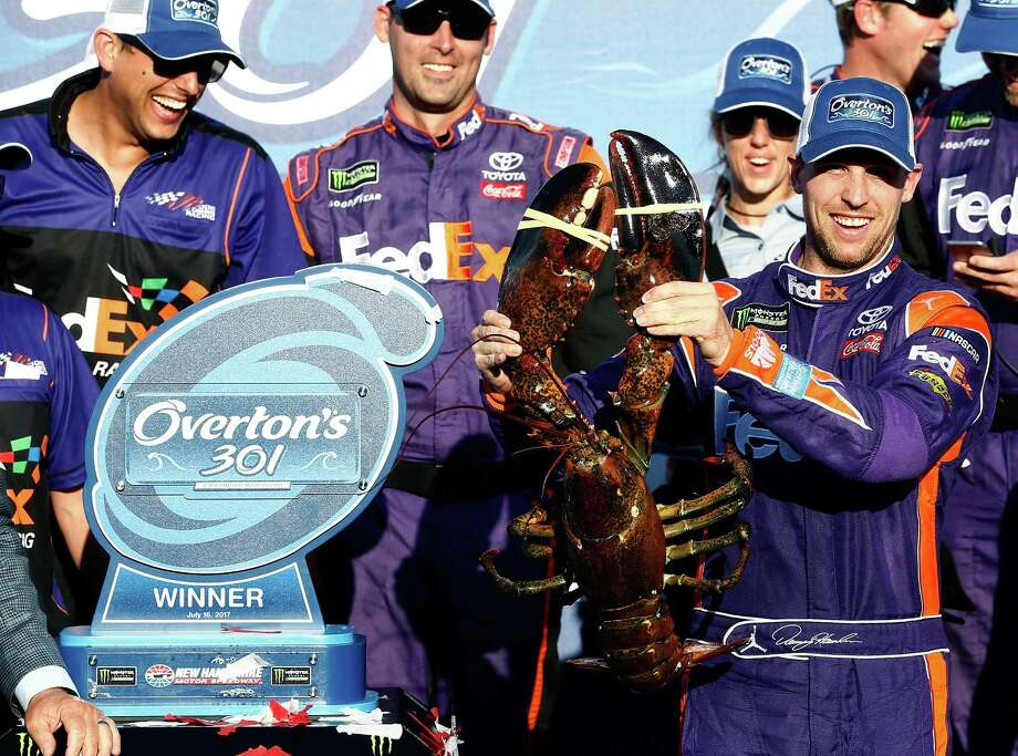 LOUDON, NH - JULY 16:  Denny Hamlin, driver of the #11 FedEx Office Toyota, poses with a lobster in Victory Lane after winning the Monster Energy NASCAR Cup Series Overton's 301 at New Hampshire Motor Speedway on July 16, 2017 in Loudon, New Hampshire.  (Photo by Jeff Zelevansky/Getty Images) ORG XMIT: 775004886 Photo: Jeff Zelevansky / 2017 Getty Images