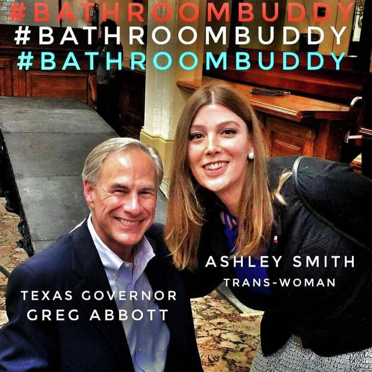 Local San Antonio activist, Ashley Smith, snaps a photo with Governor Greg Abbott after Abbott announced he would run for a second term during a special event in San Antonio Friday July 14, 2017, at Sunset Station.