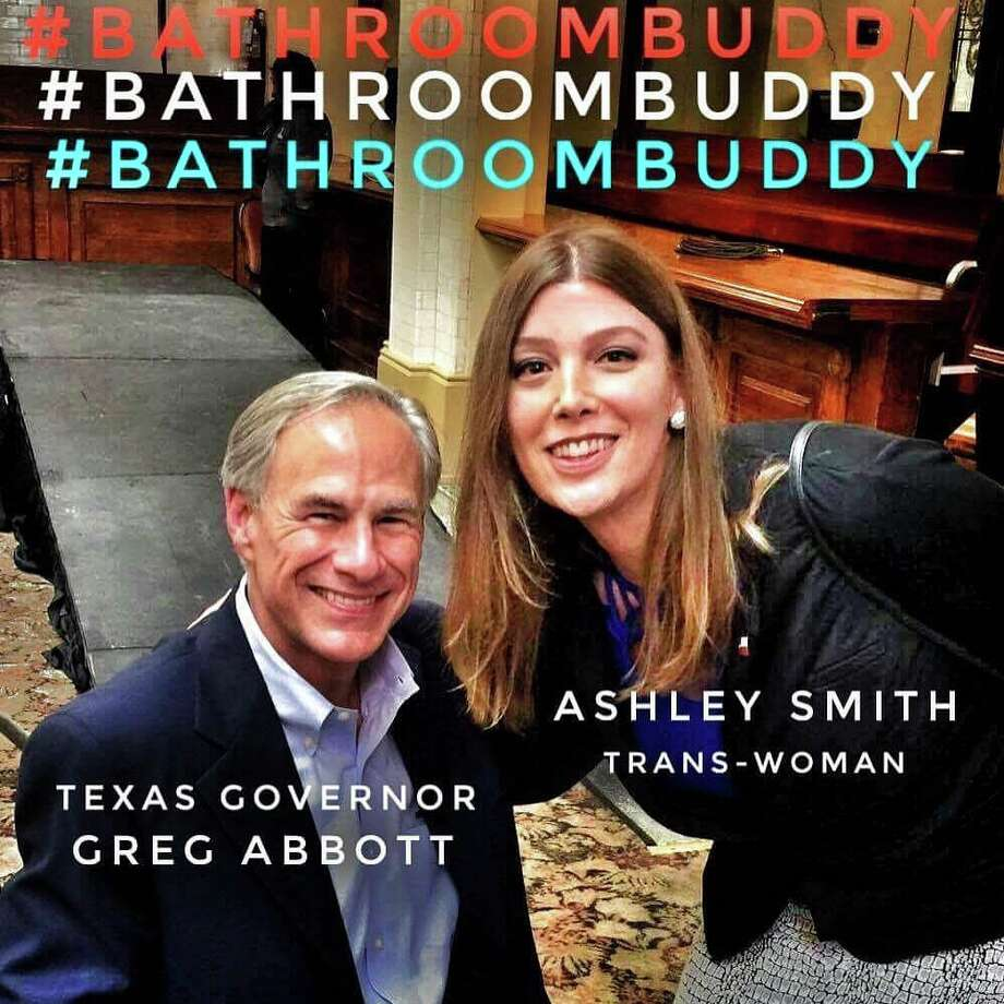 San Antonio activist Ashley Smith snaps a photo with Governor Greg Abbott after he announced he would run for a second term during a special event in San Antonio Friday July 14, 2017, at Sunset Station. Photo: Courtesy, Ashley Smith