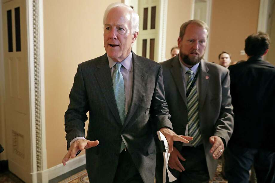 Senate Majority Whip John Cornyn (R-TX) leaves a meeting on the new version of a health care bill. Photo: Chip Somodevilla, Staff / 2017 Getty Images