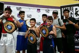 From left, Austin Alvarado, Emilio Garcia, Roy Garcia and Jose Luis Martinez from Baby Joey's Boxing Club all won titles Sunday at the Battle in Big D.