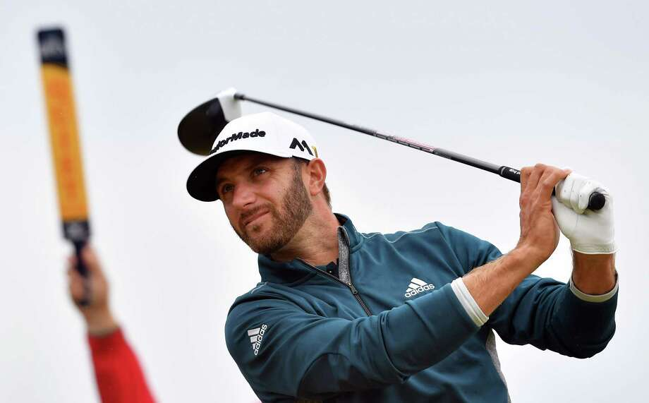 (FILES) This file photo taken on July 16, 2016 shows US golfer Dustin Johnson watching his drive from the 6th tee during his third round on day three of the 2016 British Open Golf Championship at Royal Troon in Scotland. The big-hitting 33-year-old won his first major at the US Open last year but has performed poorly in recent majors, missing the cut at the 2016 PGA Championship and at last month's US Open either side of sitting out the Masters after suffering a freak back injury. / AFP PHOTO / Ben STANSALL / RESTRICTED TO EDITORIAL USEBEN STANSALL/AFP/Getty Images Photo: BEN STANSALL / AFP or licensors