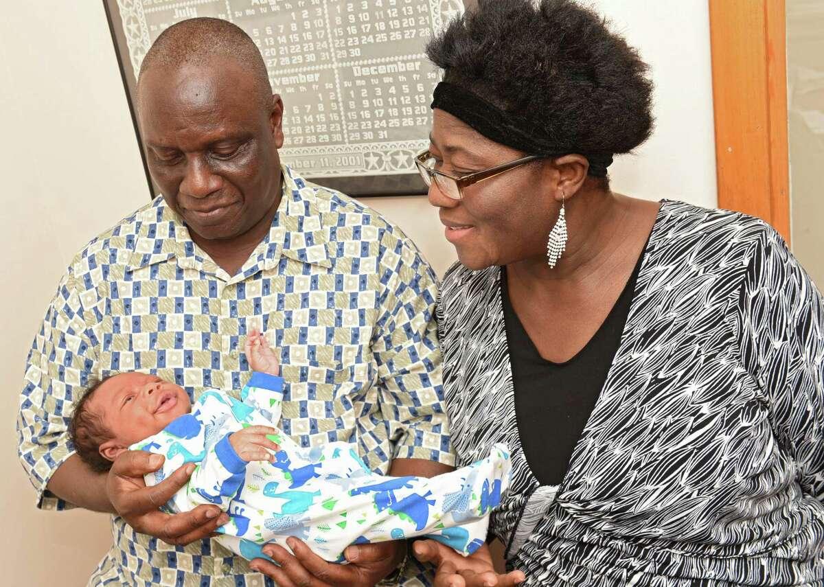 Isaiah Somuah Anim, 59, and his wife Akosua Budu Amoako, 59, hold their son Isaiah Somuah Anim, Jr. in Dr. Khushru Irani's office on Thursday, July 13, 2017 in Niskayuna, N.Y. (Lori Van Buren / Times Union)