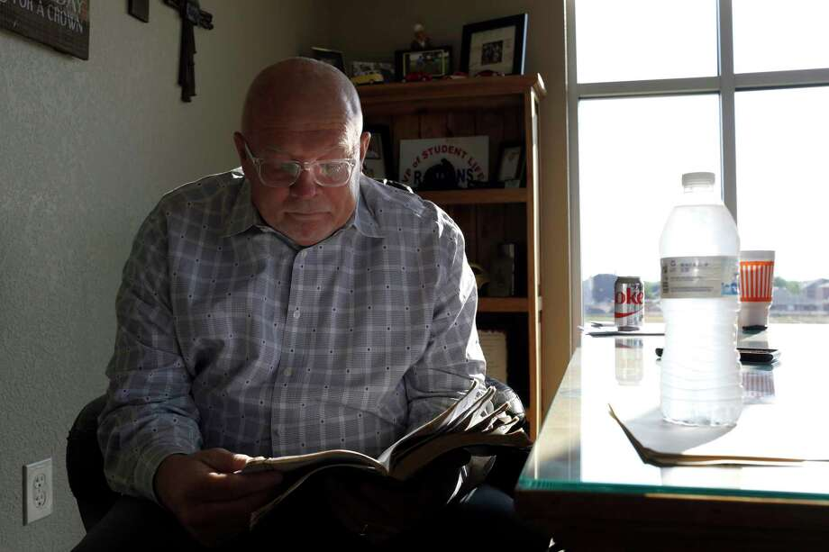 Rev. Richard Koons looks through his Bible before a giving a sermon at SouthPointe Baptist Church in Arlington, Texas on June 9, 2017. Thirty years ago a flash flood claimed the lives of ten teens from the Dallas area on their way home from church camp on July 17, 1987 in Comfort, Texas. Rev. Richard Koons was the driver of the bus that swept away and his wife, Lavonda, was swept a mile downstream.  (photo  Lara Solt) Photo: Lara Solt / Lara Solt