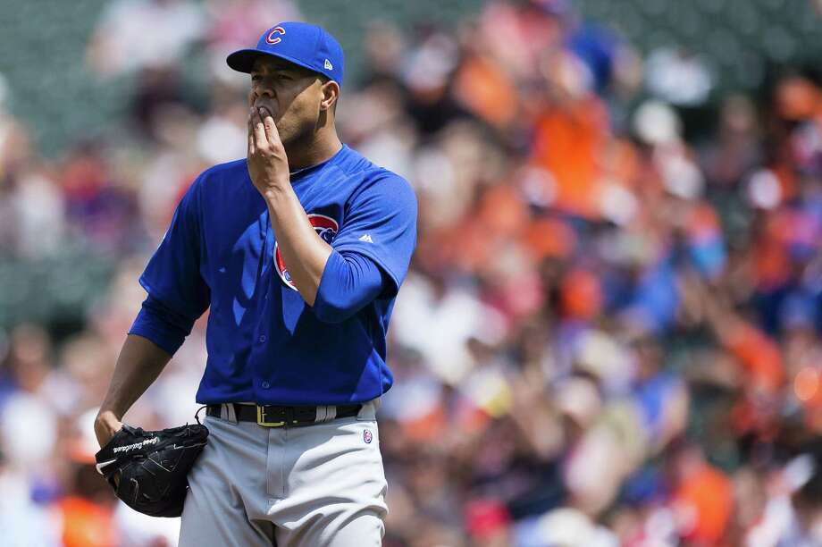 BALTIMORE, MD - JULY 16: Starting pitcher Jose Quintana #62 of the Chicago Cubs reacts after Adam Jones #10 of the Baltimore Orioles (not pictured) hit a ground rule double to left in the fourth inning during a game at Oriole Park at Camden Yards on July 16, 2017 in Baltimore, Maryland. (Photo by Patrick McDermott/Getty Images) ORG XMIT: 700011626 Photo: Patrick McDermott / 2017 Getty Images
