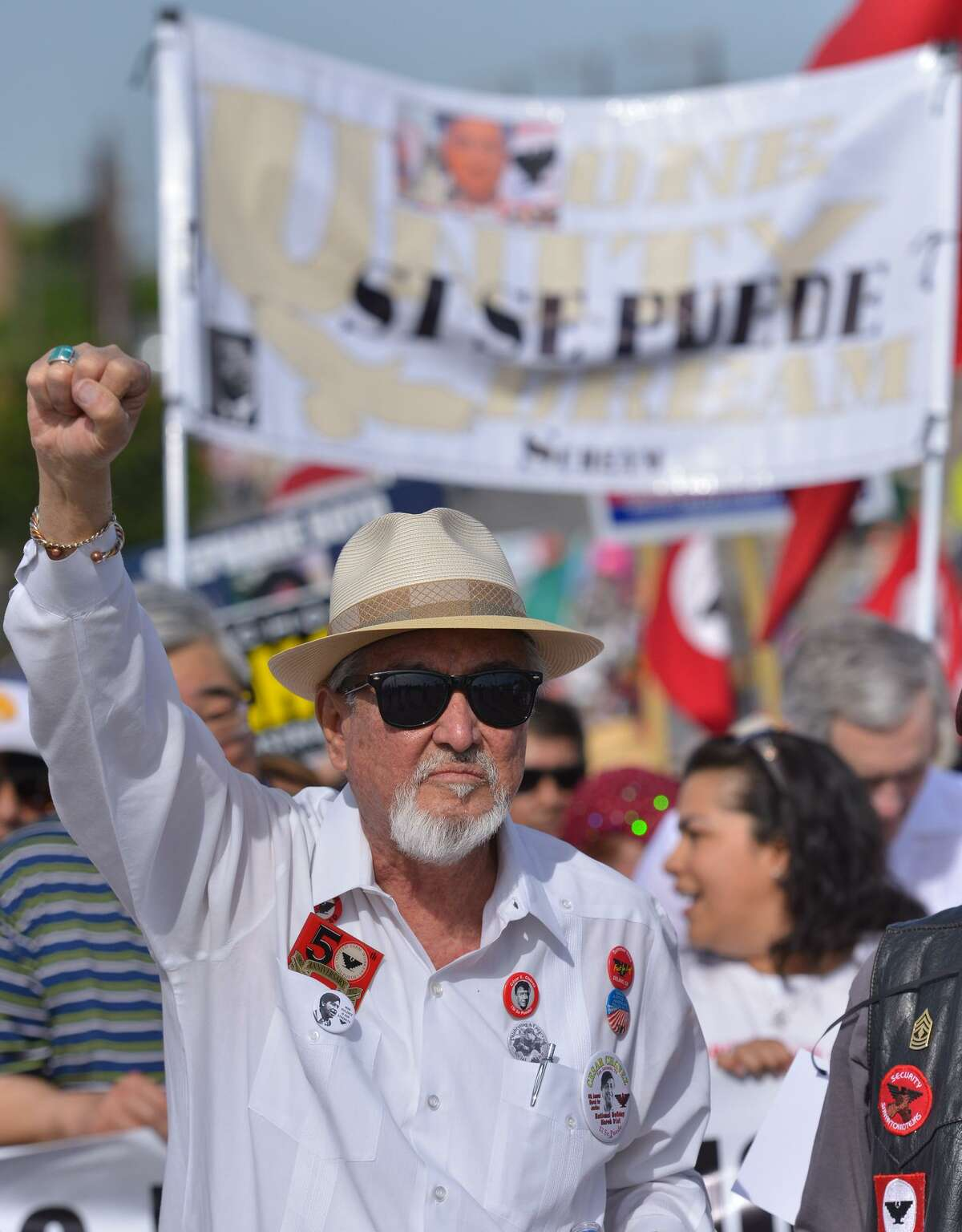 Cesar Chavez March organizer Jaime Martinez chants while crossing the Guadalupe St. bridge during the march Saturday.