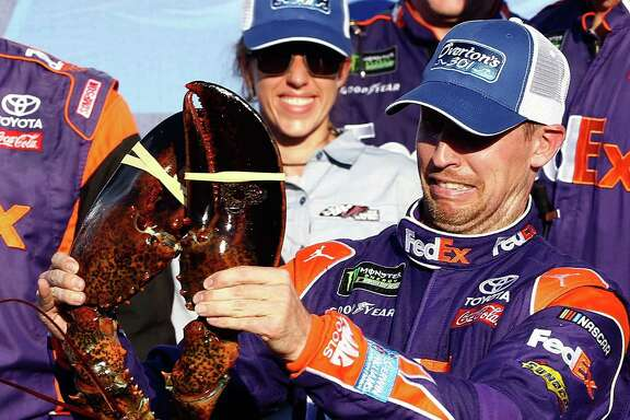 It was Denny Hamlin's turn at a much-celebrated New Hampshire Motor Speedway tradition - posing and grimacing with a giant lobster - after winning the Monster Energy Cup race Sunday.