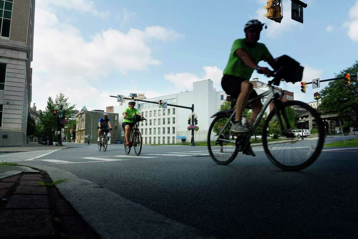 Bicyclists taking part in the 400-mile cross-state Cycle the Erie Canal trip make their way along Broadway to the finish line at the Albany Visitors Center on Sunday, July 16, 2017, in Albany, N.Y. This year 650 cyclists ages 3 to 83 took part in the ride. (Paul Buckowski / Times Union)
