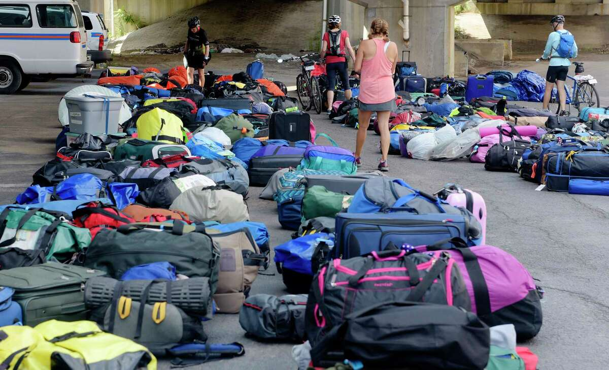 Bicyclists taking part in the 400-mile cross-state Cycle the Erie Canal trip search for their luggage at the Albany Visitors Center after finishing the ride on Sunday, July 16, 2017, in Albany, N.Y. This year 650 cyclists ages 3 to 83 took part in the ride. (Paul Buckowski / Times Union)